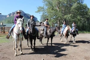 7d Ranch - Group getting ready to go out on horseback.