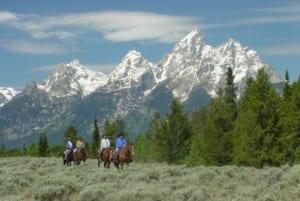 Lost Creek Ranch - Horseback riders on the plains.