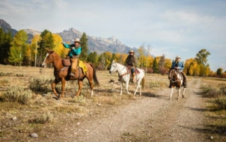 Group of wranglers on the ranch grounds.